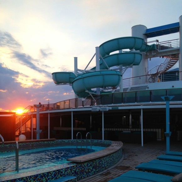 The adults only deck with a view of our last-night sunset and the water slide.