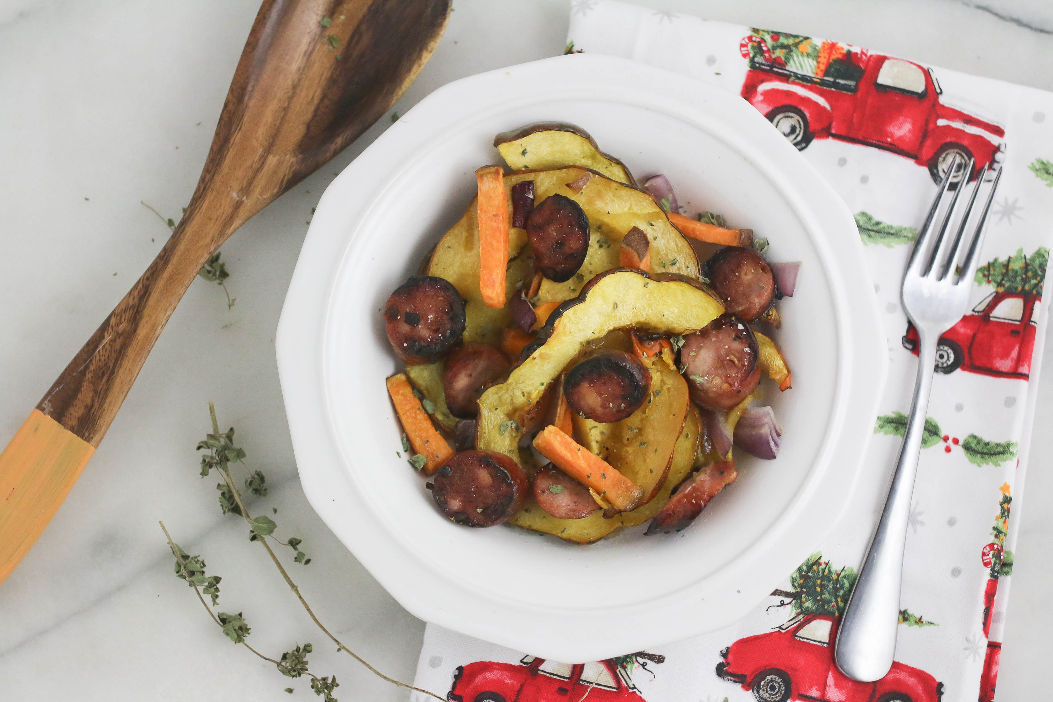 Chicken apple sausage and acorn squash one pan meal. So easy! Can completely make ahead then throw in the oven.